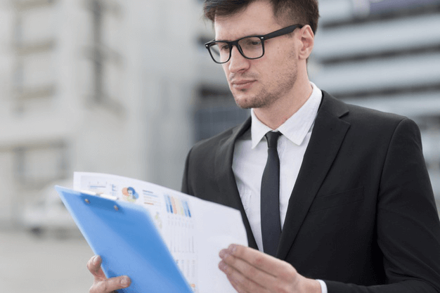 business man reading documents