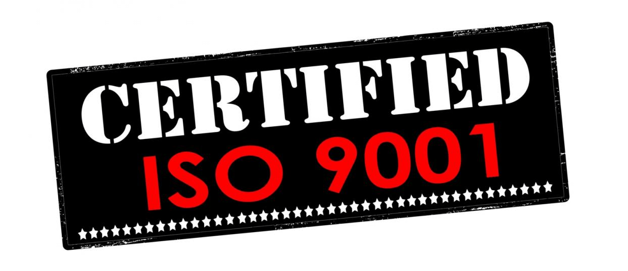 Rubber stamp for ISO certification.