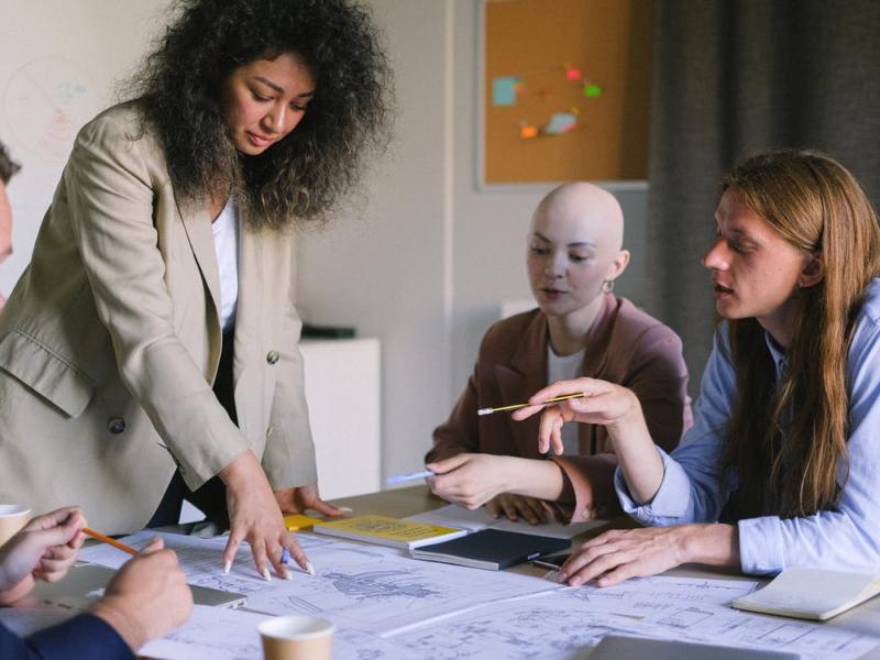 Employees in a board room